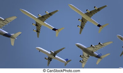 Modern commercial airliners flying against blue sky. Travel,...