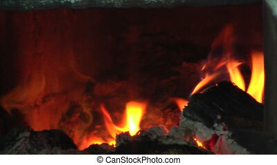 Firewood burns down in the furnace