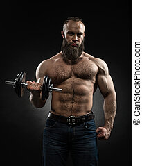 Strong bearded bodybuilder with six pack, perfect abs,...