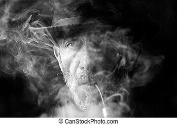 Man in the smoke - Portrait of man with pipe,monochrome and...