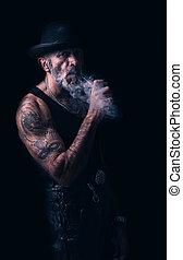 Old urban man - Portrait of urban man who smoking pipe,low...