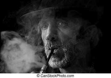 Smoking man portrait - Man smoking his pipe,monochrome...
