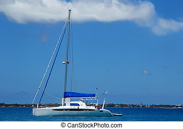 Sailboat anchired near Pangaimotu island in Tonga. Kindom of...
