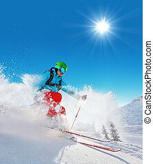 Freeride skier on piste running downhill - Freeride skier...