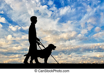 Disabled blind with cane and holding dog guide day - Blind...