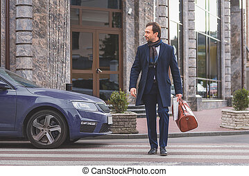 Businessman going on street with briefcase - Confident man...
