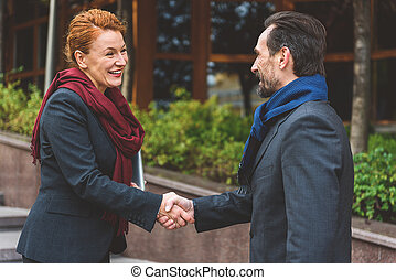 It is nice to meet you - Joyful businessman and woman are...