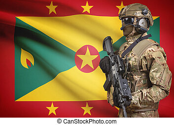 Soldier in helmet holding machine gun with flag on...