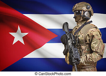 Soldier in helmet holding machine gun with flag on background series - Cuba