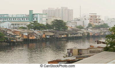 Views of the city's slums from the river 1 - Views of the...