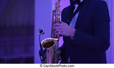 Musician man playing saxophone unrecognizable - Musician man...
