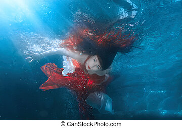 Girl in red dress under water. - Girl in red dress under...