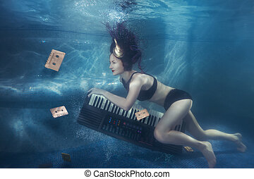 Girl with piano under water. - Girl with piano under water...