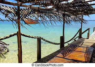 Wooden pier at Pangaimotu island near Tongatapu in Tonga....