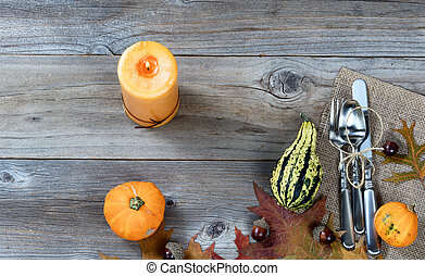 Dinnerware setting for autumn Thanksgiving holiday on rustic wooden boards