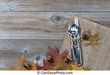 Dinnerware setting for autumn holidays on rustic wooden boards