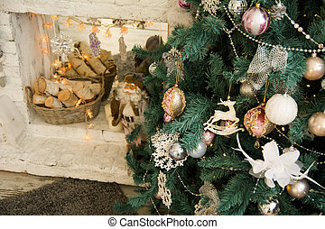 Christmas tree on the background of the fireplace with birch...