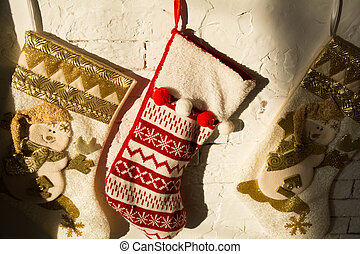 Christmas stockings on a background of a brick wall in a...