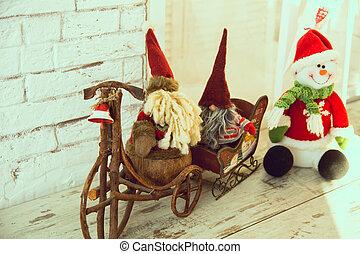 Gnomes biking and sledding snowman - Gnomes biking and...