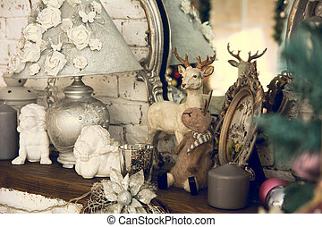 Shelf with mirror lamp candles, angels on the background of...