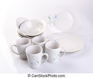 plate or ceramic tableware on the background. - plate or...