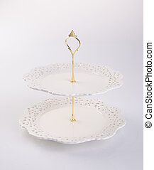 tray or two tier serving tray on a background. - tray or two...
