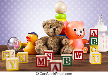 Children's of toy accessories on wooden background