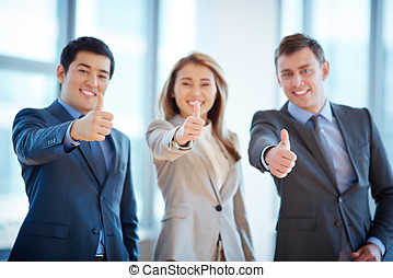 Business winners in office - Group of business people giving...