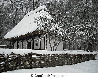 winter landscape - old wooden houses covered with snow on...
