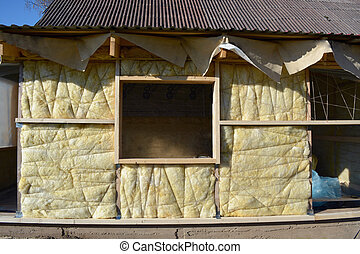 wooden house wall with mineral wool construction - insulated...