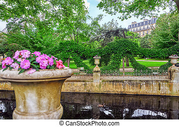 Pond near Medici Fountain in Luxembourg Palase-one of the most beautiful parks in Paris. France.