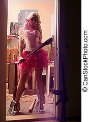 Sexy and complacent blonde woman in pink skirt and corset -...