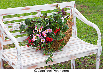 A romantic arrangement with a cornucopia filled with...