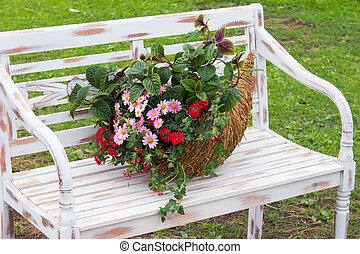 A romantic arrangement with a cornucopia filled with...