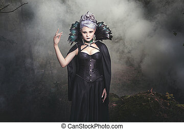 Woman witch smoke. - Beautiful woman conjures witch in the...
