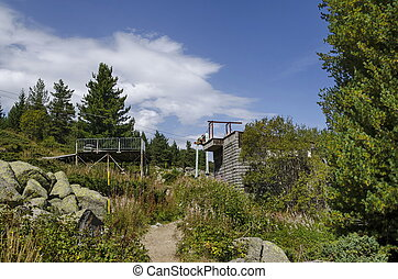 Station of old ski tow or lift in sunny day with blue sky...
