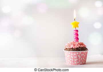 Pink Birthday Cupcake with Candle Light Background with Bokeh