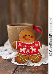Smiling christmas gingerbread men on wooden background. -...