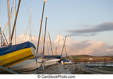 Docked Hulls - Low angle shot of small boats hulls against...