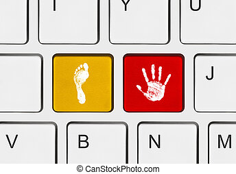 Printout of hand and foot on computer keys