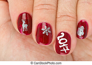 Finger nail with christmas pattern isolated on white...
