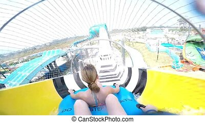 Slope down by water slide in water park. Fun travel inside...