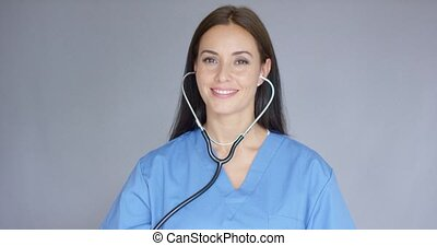 Smiling friendly nurse or doctor with stethoscope