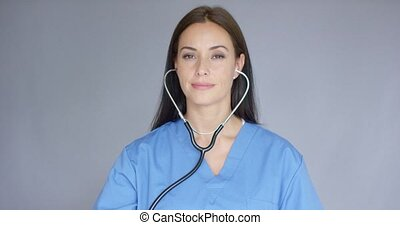 Smiling friendly nurse or doctor with stethoscope - Smiling...