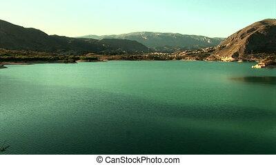 """Zoom from water resevoir """"Embalse de Amadorio"""" to the..."""