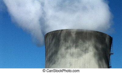 pan between top of cooling towers with white smoke from...
