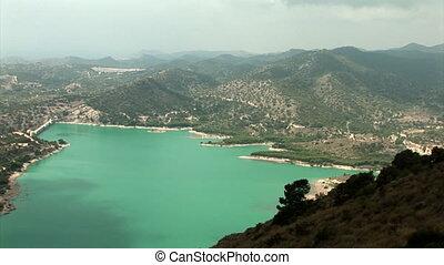 """Medium shoot from above of water reservoir """"Embalse de Amadorio"""" in Orxeta, Spain."""