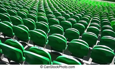 Seating rows in a stadium with weathered chairs - Green...