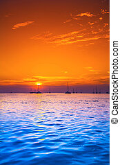 Yachts in the sea at sunset - Yachts in beautiful tropical...