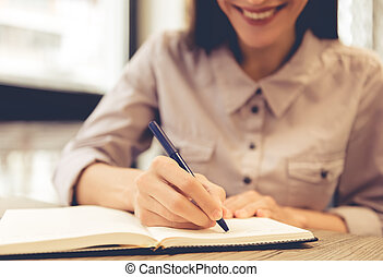 Young business woman working - Cropped image of beautiful...